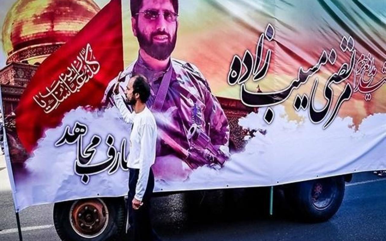 """تصویر از نگارش کتاب شهید مدافع حرم """"مرتضی مسیب زاده"""" در شهرستان فردیس"""