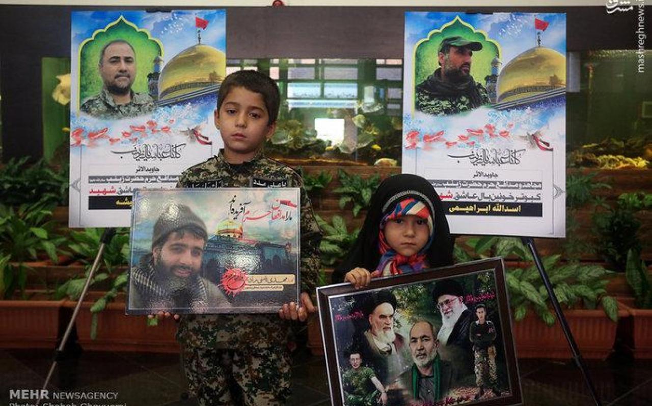 تصویر از عکس/ آئین بزرگداشت و تجلیل از خانواده ۱۹ شهید مدافع حرم