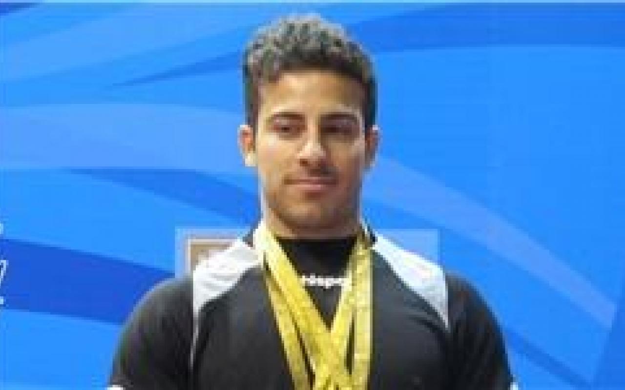تصویر از قهرمان المپیک مدال های خود را به سردار سلیمانی اهدا کرد