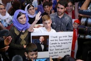 تصویر از بازگشت پسر ۱۲ساله به خانواده بعد از ۳سال اسارت در دست داعش (عکس)