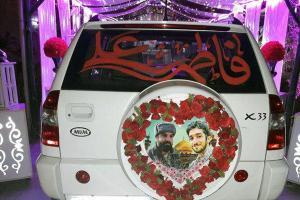 تصویر از ماشین عروس زوج شهر قدسی مزین به تصاویر شهید «محسن حججی» شد